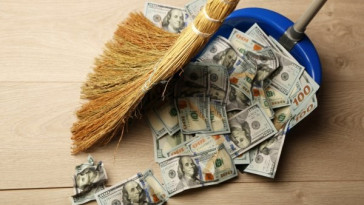 depositphotos_80214344-stock-photo-broom-sweeps-dollars-in-garbage
